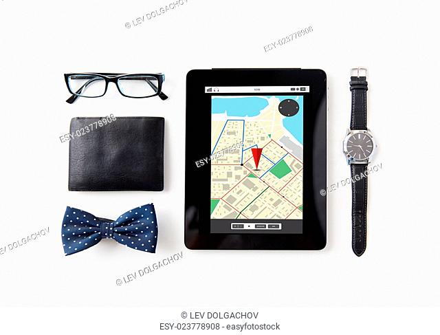 technology and objects concept - tablet pc computer with gps navigator map, wallet, eyeglasses, bowtie and wristwatch on table