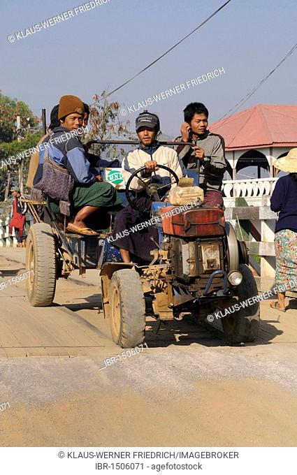 Farmers on a small tractor returning from the fields, Nyaung Shwe, Inle Lake, Shan State, Myanmar, Burma, Southeast Asia, Asia