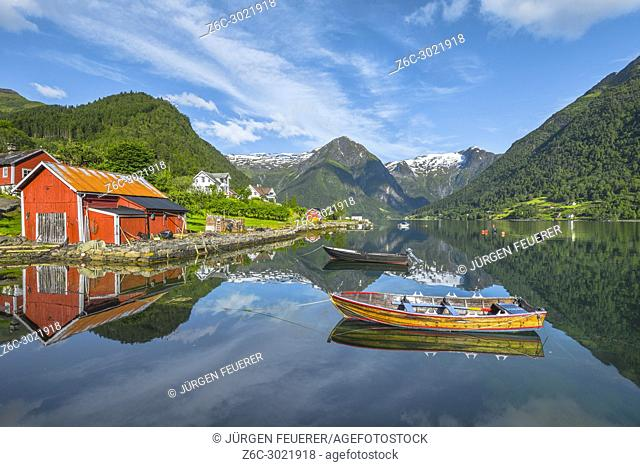 boats and red fishermen hut, Norway, seahore and bay of Balestrand with mirroing of glacier mountains, Esefjorden, Sognefjorden