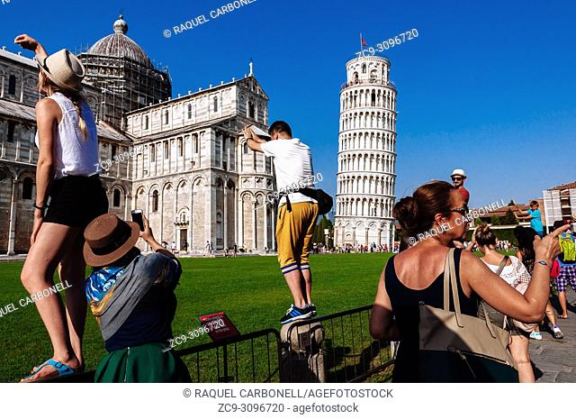 Tourists taking photos of the Cathedral and Leaning Tower, Pisa, Tuscany, Italy