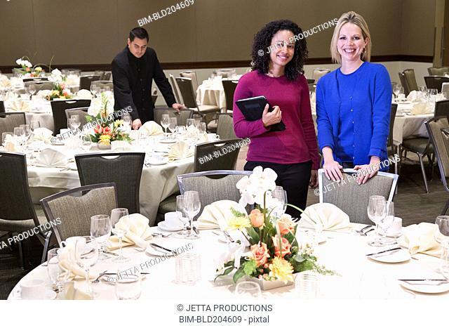 Businesswomen smiling in dining room
