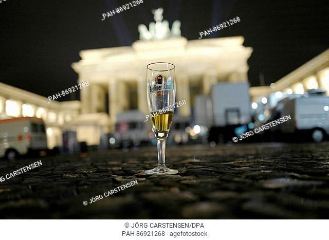After the New Year's Eve celebrations an almost empty glas of beer stands in front of the Brandenburg Gate on «Pariser Platz» in Berlin, Germany