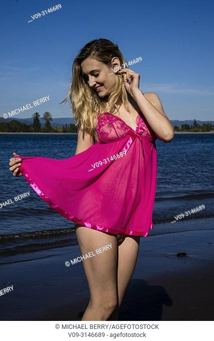 Woman outdoors in negligee
