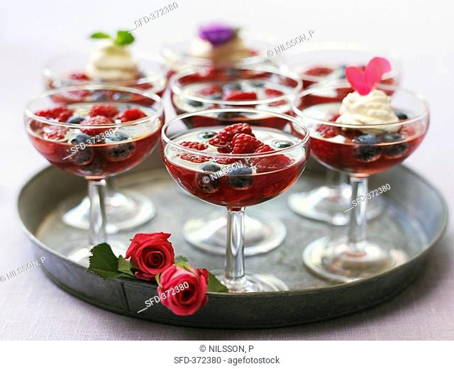 Punch with raspberries and blueberries