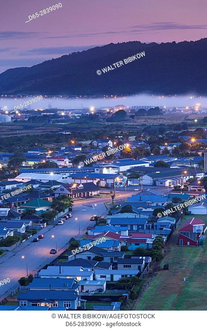 New Zealand, South Island, West Coast, Greymouth, elevated town view with fog, dawn