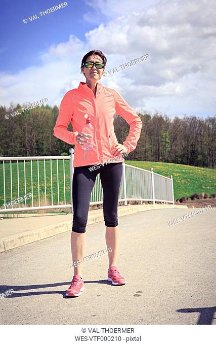 Portrait of female jogger having a break