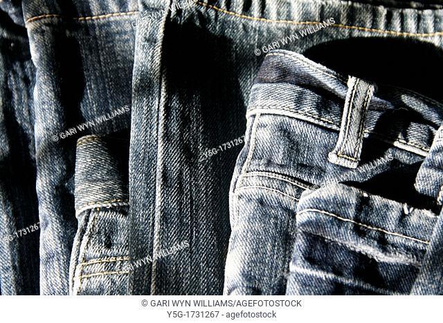 close up detail of blue denim jeans trousers pants