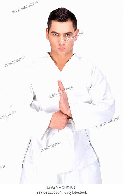 Karate martial arts. Fighter is looking at the camera, isolated on white background