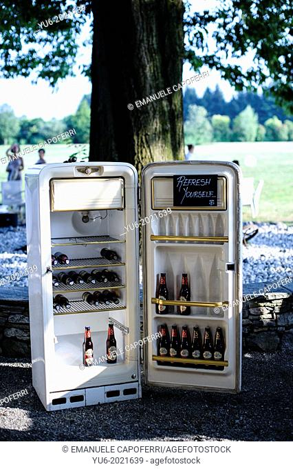 vintage fridge with beers outdoors for wedding party