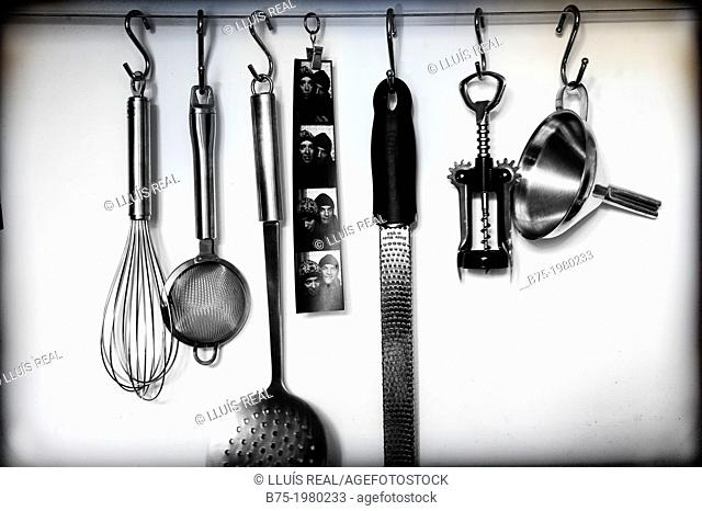 Kitchen utensils hanging on a wall