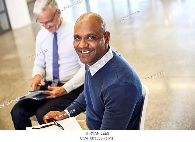 Portrait smiling businessman in meeting