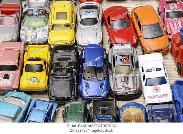 heap of vintage toy cars on sale in bric-a-brac antiques street market, shot at Mediterranean little town of Chiavari, Genova, Liguria, Italy