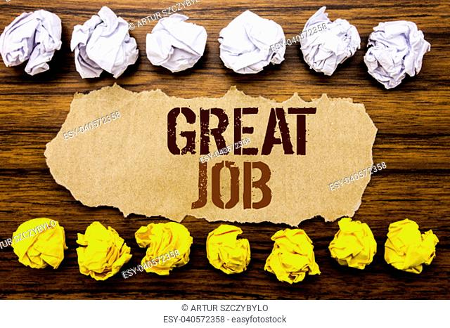 Conceptual hand text word Great Job. Business concept for Success Appreciation Written on sticky, wooden with sticky, many folded paper white and yellow for...