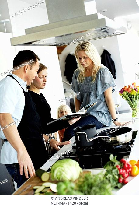 A man and two women making dinner together Sweden