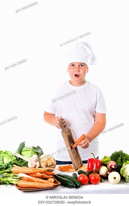 astonished young cook grating carrots