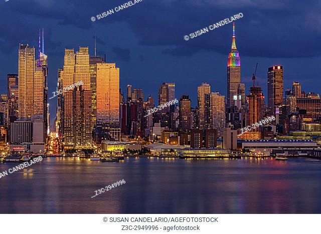 New York City Skyline Pride - The midtown Manhattan NYC skyline is bathed with warm and cool hues during the blue hour at twilight