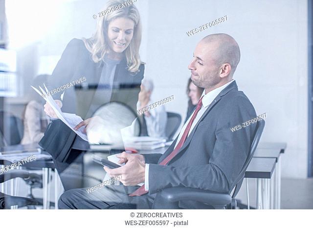Businesspeople having meeting in board room