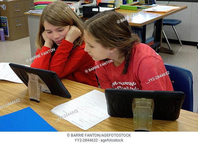6th Grade Girls Using iPad for Lesson, Wellsville, New York, USA