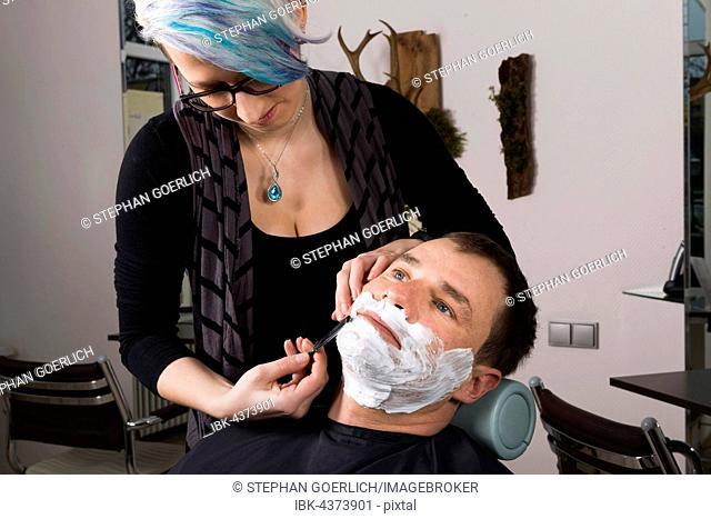 Man having wet shave, hair salon, Germany