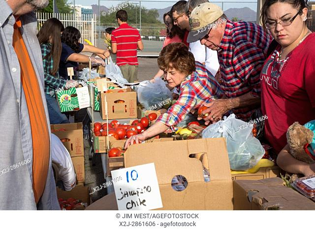 Tucson, Arizona - Student volunteers from Tucson High School distribute produce provided by the Borderlands Food Bank. The food bank rescues 30 to 40 million...