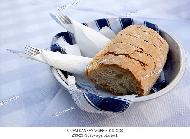 Fresh multi cereal bread on the plate, Naxos, Cyclades Islands, Greek Islands, Greece, Europe