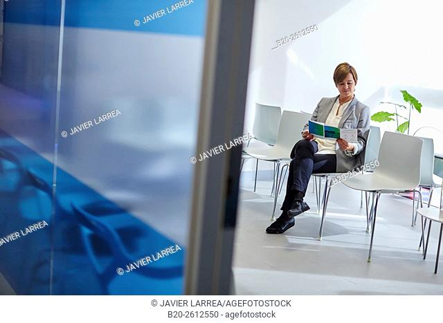 Woman, Waiting room, Hospital, Donostia, San Sebastian, Gipuzkoa, Basque Country, Spain