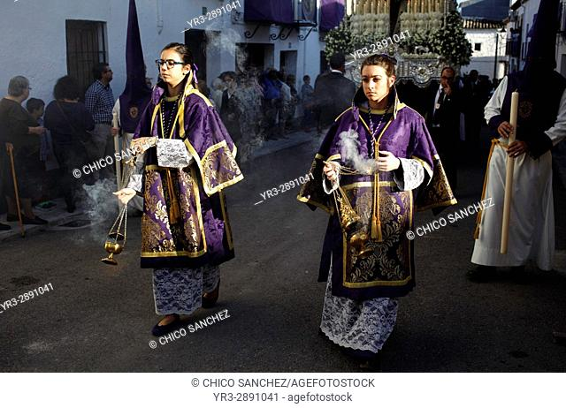 Altar girls spread incensé during Easter Week celebrations in Baeza, Jaen Province, Andalusia, Spain