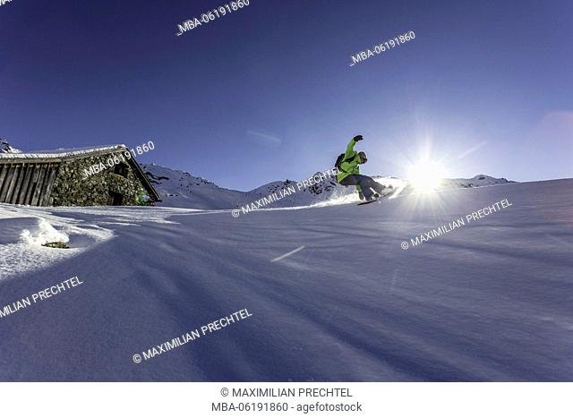 Snowboarder, Powder turn against the light