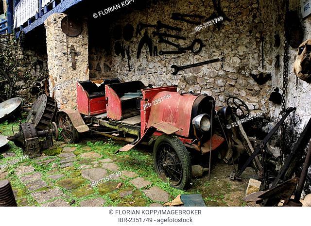 Scrap car, vintage car on the dilapidated Muricana farmyard near Paraty or Parati, Costa Verde, State of Rio de Janeiro, Brazil, South America