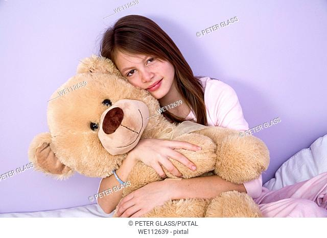 Preteen girl with a stuffed animal
