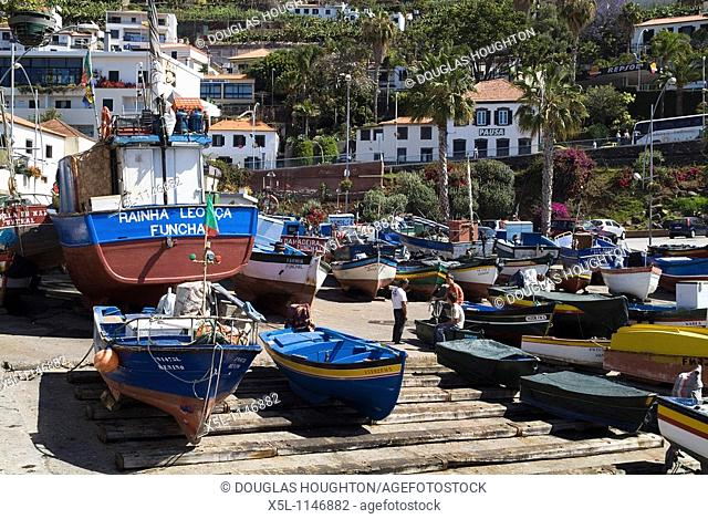 CAMARA DE LOBOS MADEIRA Colourful fishing boats beached on slipway