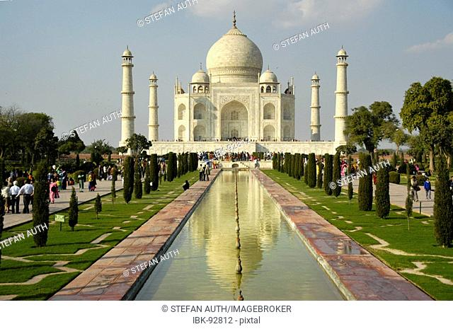 Classical view of the Taj Mahal with its reflection in the water Agra Uttar Pradesh India
