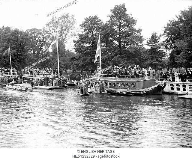 Spectators on the University barges watching a boat race during Eights Week, Oxford, Oxfordshire, c1860-c1922