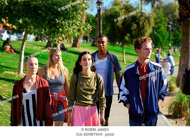 Five young adult friends strolling in park, Los Angeles, California, USA