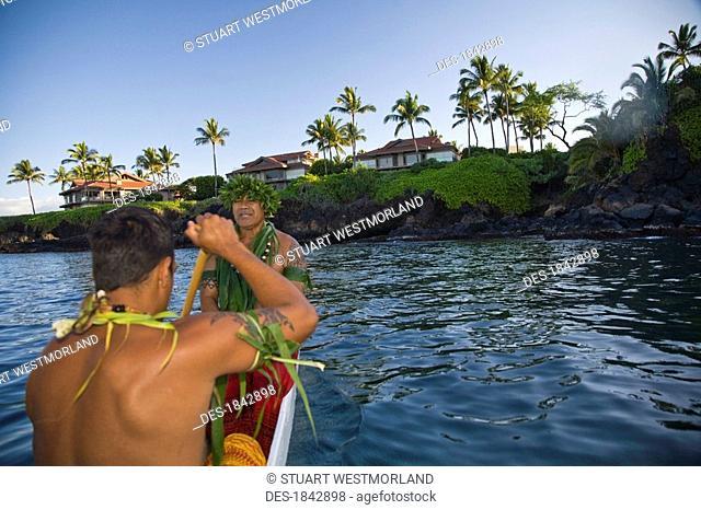 Wailea,Hawaii,USA,Hawaiian men paddling a canoe