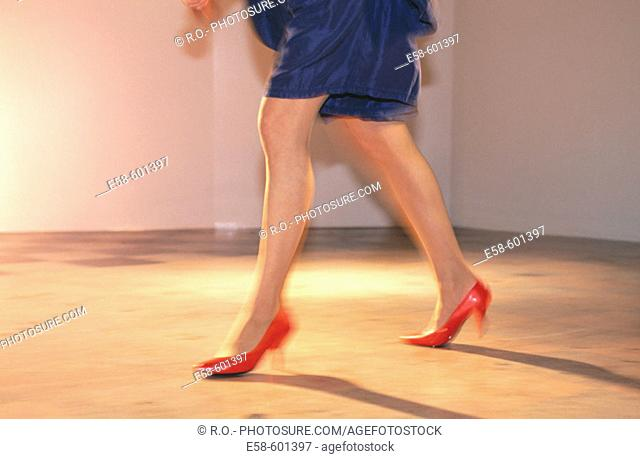 Female legs, red shoes