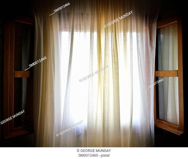 Curtain draped Window,. Frigiliana, . Andalucia, Spain