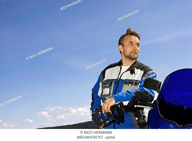 Germany, Bavaria, Biker with motorbike, close up