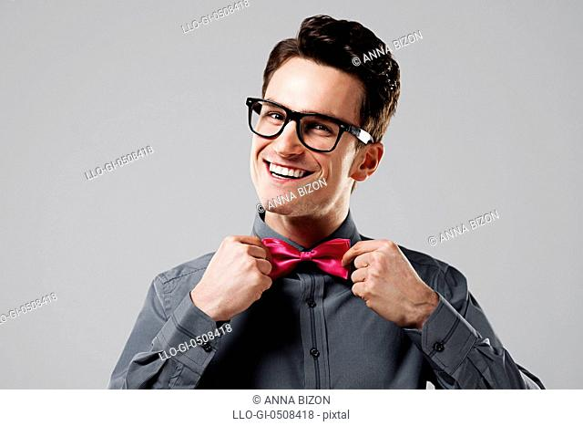 Smiling man with pink bow tie Debica, Poland