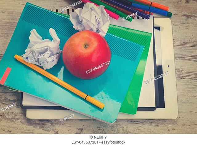 Apple with school supplies on white wooden table, top view, retro toned
