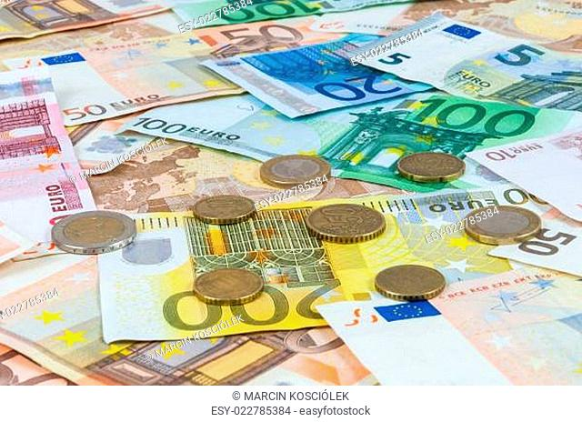 Background of euro banknotes and coins