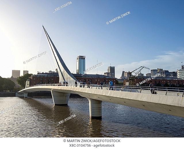Puente de la Mujer a rotating footbridge designed by architect Stantiago Calatrava. Puerto Madero, the modern living quarter around the old docks of Buenos...