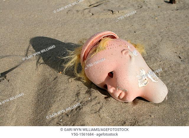 doll's head washed up on beach