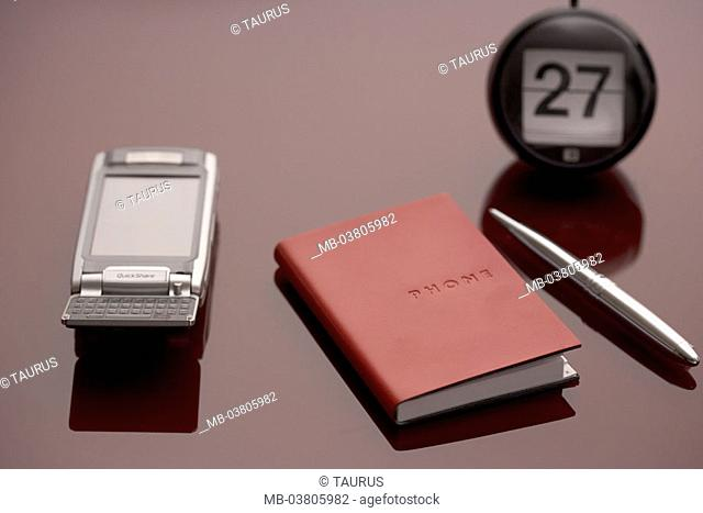 Table, calendars, address book,  Pen, cell phone,   Office, job, desk, portable phone, telephone, folding cell phone, telephone book, ballpoint pens, notes