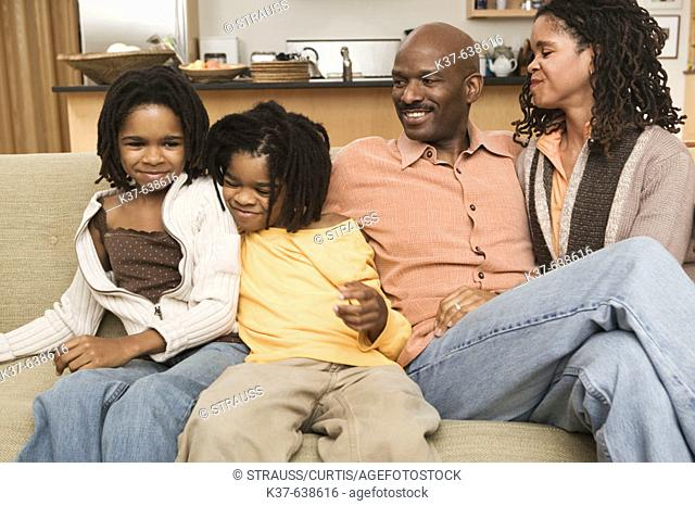 African American family at home sitting in livingroom
