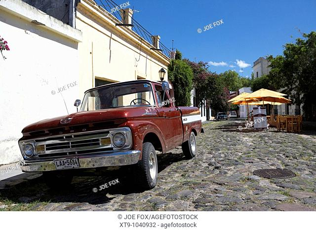 old ford pickup truck on historic paved spanish street with high kerbstones in Barrio Historico Colonia Del Sacramento Uruguay South America