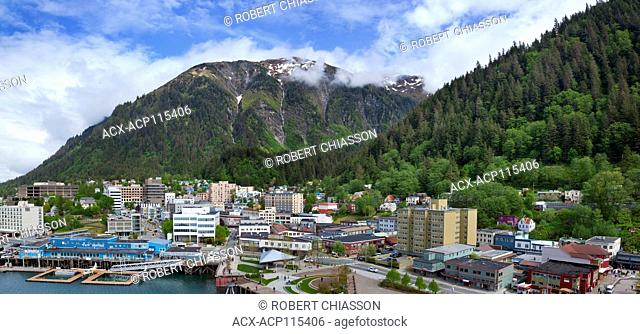 Juneau, the capital city of Alaska, and Mount Juneau towering above it, Alaska, U.S.A. The slope on the right is the base of Mount Roberts