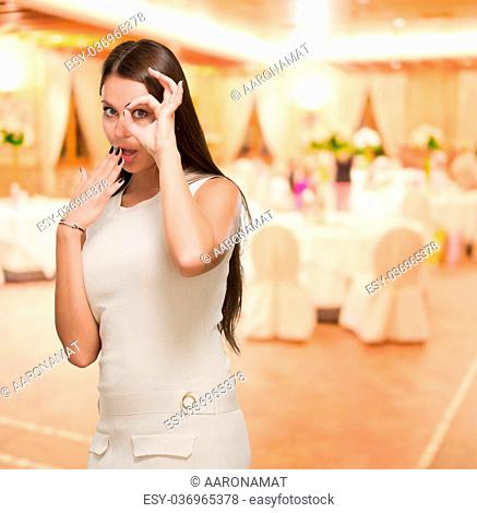 Surprised Young Woman Looking Through Imaginary Binocular in a restaurant