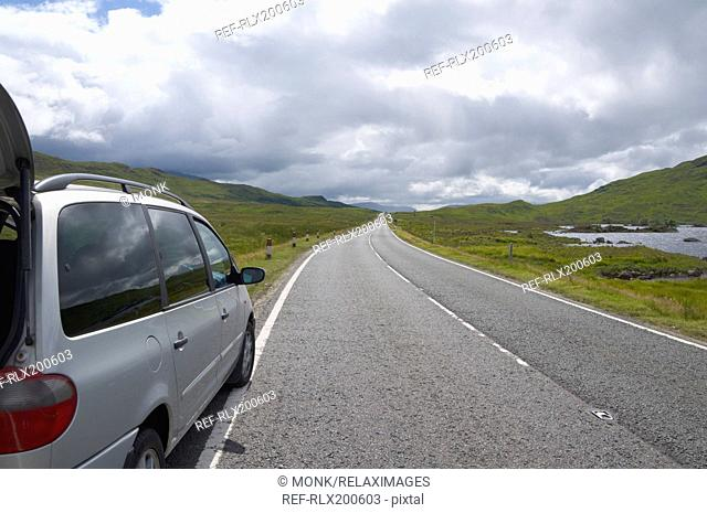 Car parked on empty road at Rannoch Moor, Strathclyde, Scotland, U.K
