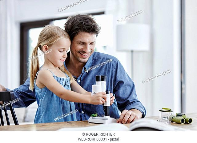 Father and daughter with binocular